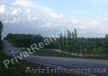 Участок 48 соток,  красная линия трассы,  10 км от Харькова.